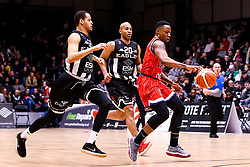 Panos Mayindombe of Bristol Flyers goes past Kyle Williams and Fabulous Flournoy of Newcastle Eagles - Photo mandatory by-line: Robbie Stephenson/JMP - 01/03/2019 - BASKETBALL - Eagles Community Arena - Newcastle upon Tyne, England - Newcastle Eagles v Bristol Flyers - British Basketball League Championship