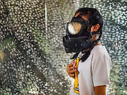 "14 JANUARY 2017 - BANGKOK, THAILAND: A Thai child tries a gas mask in a demonstration of gas masks during Children's Day activities at the King's Guard, 2nd Cavalry Division base in Bangkok. Thailand National Children's Day is celebrated on the second Saturday in January. Known as ""Wan Dek"" in Thailand, Children's Day is celebrated to give children the opportunity to have fun and to create awareness about their significant role towards the development of the country. Many government offices open to tours and military bases hold special children's day events. It was established as a holiday in 1955.       PHOTO BY JACK KURTZ"