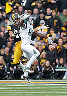 November 12, 2011: Michigan State Spartans wide receiver Keshawn Martin (82) can't pull in a pass as Iowa Hawkeyes cornerback Micah Hyde (18) defends during the second half of the NCAA football game between the Michigan State Spartans and the Iowa Hawkeyes at Kinnick Stadium in Iowa City, Iowa on Saturday, November 12, 2011. Michigan State defeated Iowa 37-21.