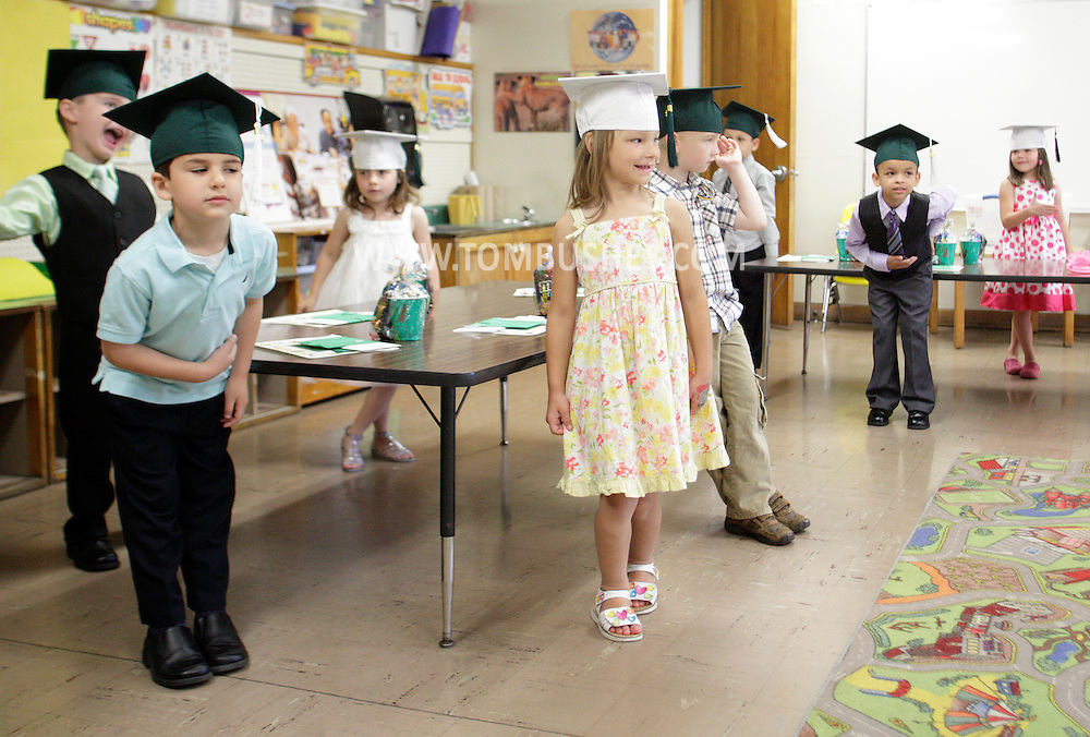 Students in Eileen Jacobs' kindergarten classroom at Minisink Valley Elementary School practice bowing before their graduation ceremony on Tuesday, June 19, 2012.