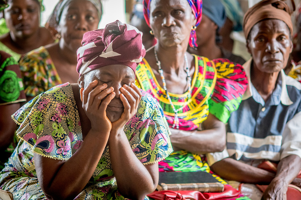A woman closes her eyes meditatively in a church service in Ganta,Liberia
