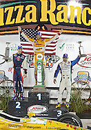 Marco Andretti, Ryan Hunter-Reay, and Tony Kanaan in victory lane after the IZOD IndyCar Iowa Corn Indy 250 auto race at the Iowa Speedway in Newton, Iowa on Saturday, June 23, 2012.