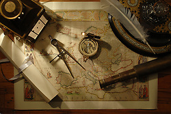 nautical navigation tools on old world map