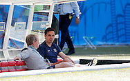 Rasy Lewington (left) and Gary Neville, coaches of England during the 2014 FIFA World Cup match at Mineir&atilde;o, Belo Horizonte, Brazil. <br /> Picture by Andrew Tobin/Focus Images Ltd +44 7710 761829<br /> 24/06/2014