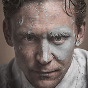Portrait of Tom Hiddleston as Dr Robert Laing in High Rise. <br />