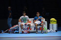 November 10, 2017 - London, England, United Kingdom - Dominic Thiem of Austria (L) and David Goffin of Belgium are pictured while sitting on the bench during a training session prior to the Nitto ATP World Tour Finals at O2 Arena, London on November 10, 2017. (Credit Image: © Alberto Pezzali/NurPhoto via ZUMA Press)