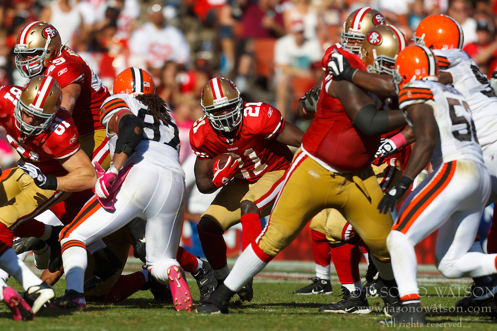 Oct 30, 2011; San Francisco, CA, USA; San Francisco 49ers running back Frank Gore (21) rushes up field against the Cleveland Browns during the third quarter at Candlestick Park. San Francisco defeated Cleveland 20-10. Mandatory Credit: Jason O. Watson-US PRESSWIRE