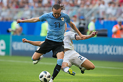 June 25, 2018 - Samara, Russia - Igor Smolnikov of Russia vies Diego Laxalt of Uruguay during the 2018 FIFA World Cup Russia group A match between Uruguay and Russia at Samara Arena on June 25, 2018 in Samara, Russia. (Credit Image: © Foto Olimpik/NurPhoto via ZUMA Press)