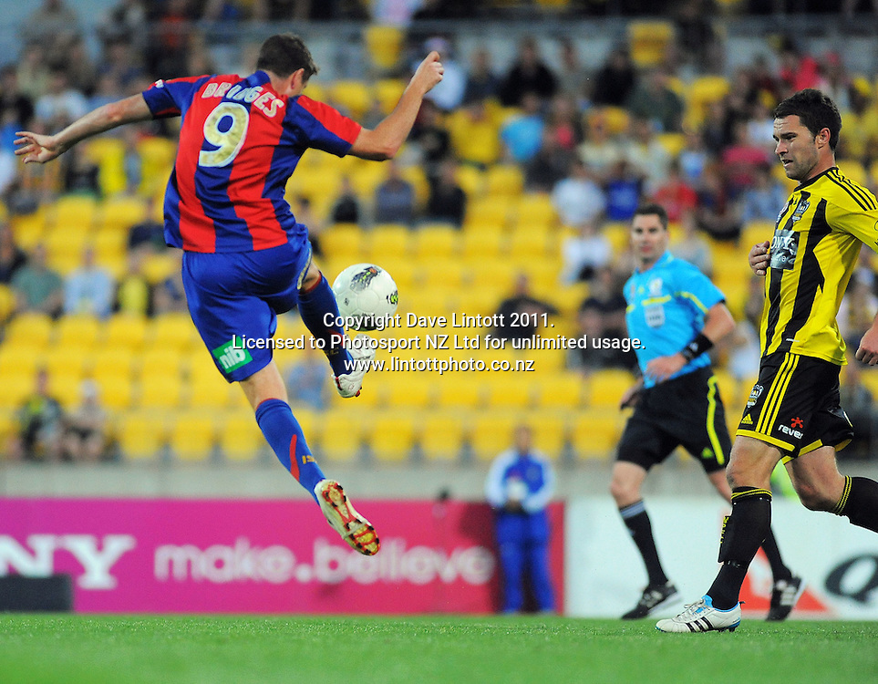 Michael Bridges controls the ball under pressure from Phoenix' Tim Brown during the A-League football match between Wellington Phoenix v Newcastle Jets at Westpac Stadium, Wellington, New Zealand on Friday, 23 December 2011. Photo: Dave Lintott / lintottphoto.co.nz