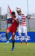 Team USA midfielder Allan Rodriguez-Lopez (13) and Portugal midfielder Marco Cruz (10) vie for a header during a CONCACAF boys under-15 championship soccer game, Saturday, August 10, 2019, in Bradenton, Fla. Portugal defeated Team USA 3-0 and advanced to the finals against Slovenia. (Kim Hukari/Image of Sport)
