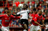 Photo. Chris Ratcliffe<br />Charlton v Fulham. FA Premiership. 11/05/2003<br />Louis Saha controls the ball in the box as Luke Young and Jonathan Fortune try to win the ball