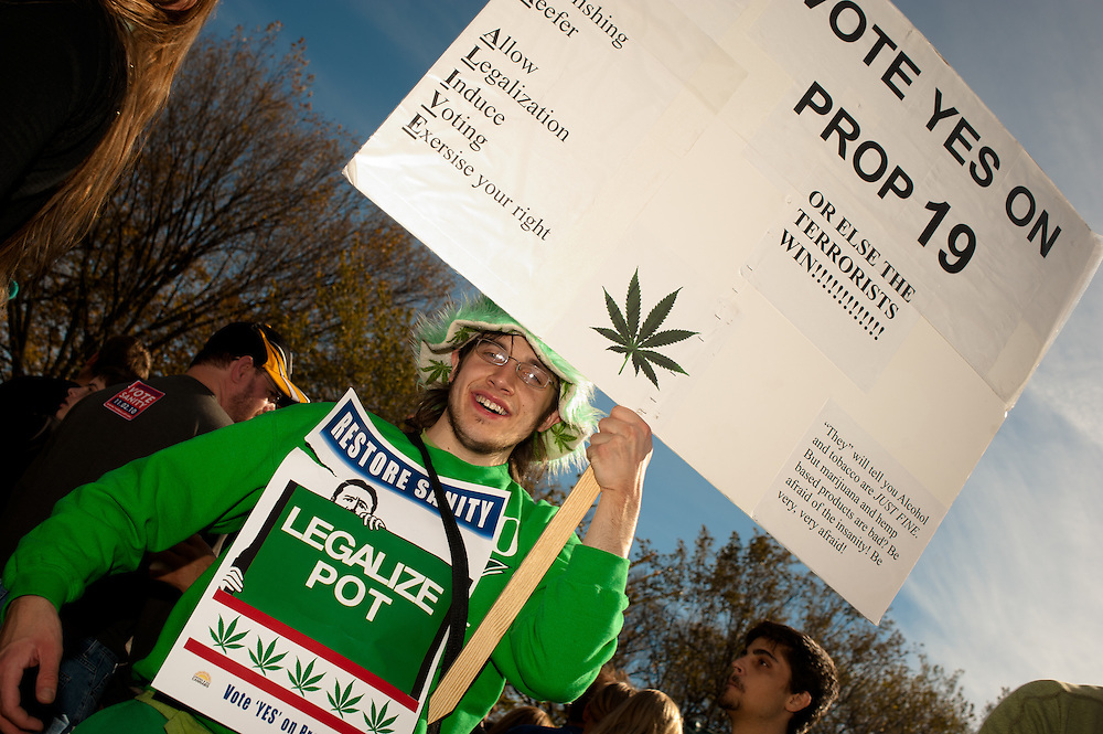 """Washington, DC, October 30, 2010 - Jon Stewert and Steven Colbert host the Rally To Restore Sanity and/or Fear.  Tens of thousands of ralliers donned costumes and carried signs. """"LEGALIZE POT / VOTE YES ON PROP 19"""""""