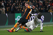 Hull City defender Josh Tymon (28) is tackles by Newcastle United midfielder Mohamed Diame (15)  during the EFL Quarter Final Cup match between Hull City and Newcastle United at the KCOM Stadium, Kingston upon Hull, England on 29 November 2016. Photo by Simon Davies.