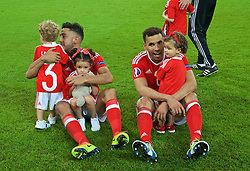 LILLE, FRANCE - Friday, July 1, 2016: Wales' Neil Taylor and Hal Robson-Kanu celebrate with their children after a 3-1 victory over Belgium and reaching the Semi-Final during the UEFA Euro 2016 Championship Quarter-Final match at the Stade Pierre Mauroy. (Pic by David Rawcliffe/Propaganda)