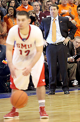 Oklahoma State head coach Travis Ford during an NCAA college basketball game against SMU, in Dallas, Wednesday, Dec. 28, 2011.