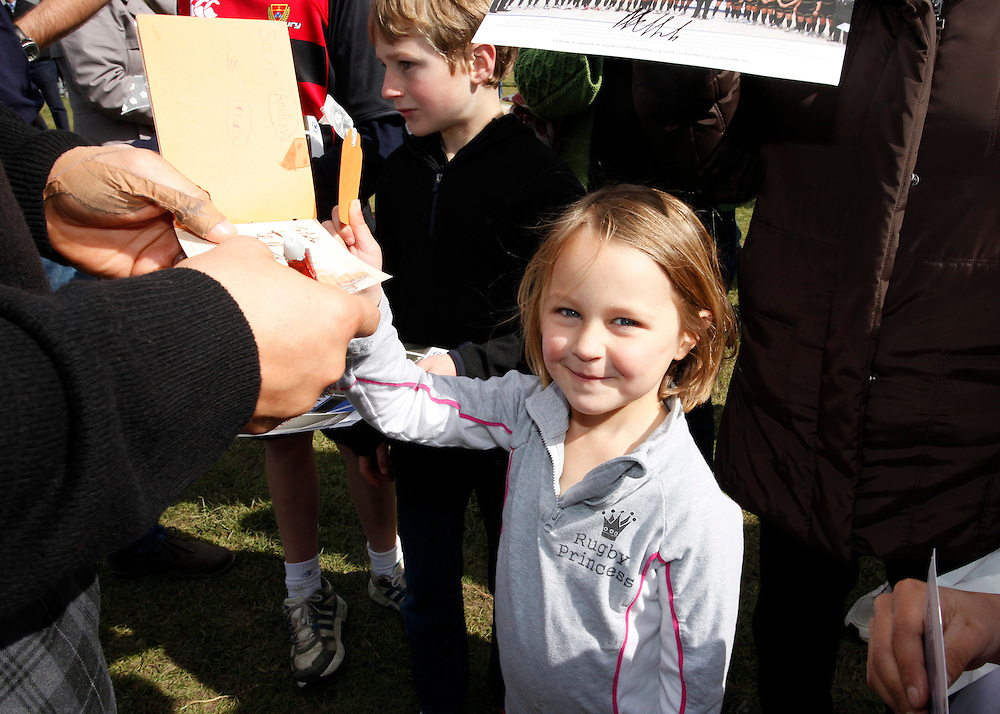4 year old Martha Luisetti came from Rangiora to get an autograph from tight-head prop Euan Murray of the Scottish World Cup Rugby team during their visit to the Fanzone, North Hagley Park, Christchurch, New Zealand, Saturday, September 17, 2011.  Credit:SNPA / Pam Johnson