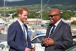 Kensington Palace handout photo of Prince Harry taking to St Kitts and Nevis Prime Minister Dr Timothy Harris at Port Zante after arriving on the island of St Kitts for the second leg of his Caribbean tour.