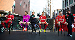 LIVERPOOL, ENGLAND - Thursday, April 10, 2014: Liverpool's Kolo Toure, goalkeeper Simon Mignolet, Philippe Coutinho Correia and Jordan Henderson at the launch of the new Warrior home kit for 2014/2015 at the Liverpool One shopping centre. (Pic by David Rawcliffe/Propaganda)