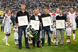 03.09.2014, Esprit-Arena, Duesseldorf, GER, FS Vorbereitung, Fussball Testspiel, Deutschland vs Argentinien, im Bild vl: Per Mertesacker (FC Arsenal), Hansi Flick, Miroslav Klose (Lazio Rom) und Philipp Lahm (FC Bayern Muenchen) bei der Verabschiedung aus der Nationalmannschaft mit Blumen // during a international football frindly match between Germany and Argentina in preparation for the upcoming EURO 2016 qualifying matches at the Esprit-Arena in Duesseldorf, Germany on 2014/09/03. EXPA Pictures © 2014, PhotoCredit: EXPA/ Eibner-Pressefoto/ Schueler<br /> <br /> *****ATTENTION - OUT of GER*****