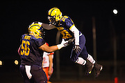 Milpitas defensive linemen Tevita Musika (56) celebrates a touchdown with running back Cros Chavez (28) during the Homecoming game against Saratoga at Milpitas High School in Milpitas, California, on October 10, 2014. Milpitas beat Saratoga 49-0. (Stan Olszewski/SOSKIphoto)