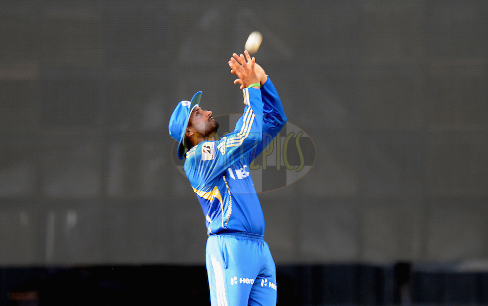 Harbhajan Singh captian of Mumbai Indians takes a catch of Ravichandran Ashwin of Chennai Super Kings  during match 49 of the Indian Premier League ( IPL) 2012  between The Mumbai Indians and the Chennai Super Kings held at the Wankhede Stadium in Mumbai on the 6th May 2012..Photo by Pal Pillai/IPL/SPORTZPICS.