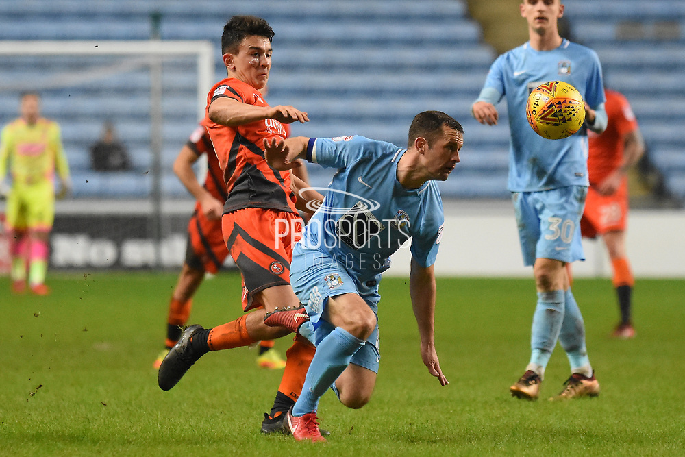 Wycombe Wanderers midfielder Luke O'Nien (17) battles with Coventry City midfielder Michael Doyle (8) 3-2 during the EFL Sky Bet League 2 match between Coventry City and Wycombe Wanderers at the Ricoh Arena, Coventry, England on 22 December 2017. Photo by Alan Franklin.