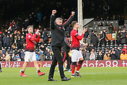 Manchester United interim Manager Ole Gunnar Solskjaer applauds the fans after victory with fist up high after the final whistle at the Premier League match between Fulham and Manchester United at Craven Cottage, London, England on 9 February 2019.