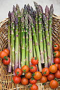 Bunches of freshly picked asparagus and cherry tomatoes in the Vale of Evesham, Worcestershire, UK