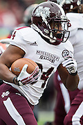 LITTLE ROCK, ARKANSAS - NOVEMBER 23:  Josh Robinson #34 of the Mississippi State Bulldogs runs the ball against the Arkansas Razorbacks at War Memorial Stadium on November 23, 2013 in Little Rock, Arkansas.  The Bulldogs defeated the Razorbacks 24-17.  (Photo by Wesley Hitt/Getty Images) *** Local Caption *** Josh Robinson
