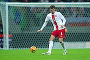 Poland's Lukasz Szukala controls the ball during international friendly soccer match between Poland and Scotland at National Stadium in Warsaw on March 5, 2014.<br /> <br /> Poland, Warsaw, March 5, 2014<br /> <br /> Picture also available in RAW (NEF) or TIFF format on special request.<br /> <br /> For editorial use only. Any commercial or promotional use requires permission.<br /> <br /> Mandatory credit:<br /> Photo by &copy; Adam Nurkiewicz / Mediasport