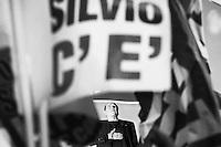 Senator Silvio Berlusconi, former Prime Minister of Italy and leader of Forza Italia, looks up while his party anthem is played at the end of an outdoor rally in central Rome during which he declared himself a victim of persecution as the Senate was voting to expel him from Parliament over his tax fraud conviction, in Rome, Italy, on November 27th 2013.<br /> <br /> ###<br /> <br /> Roma, novembre 2013. Silvio Berlusconi ascolta l'inno di Forza Italia a conclusione del suo comizio di protesta nel quale si è dichiarato vittima di persecuzioni, poco prima che il Senato votasse a favore della sua decadenza da Senatore della Repubblica.