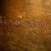 Egypt, Luxor. November/01/2008...Soft-focus on engraved bronze table-tops...