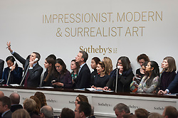 © Licensed to London News Pictures. 28/02/2018. LONDON, UK. Sotheby's staff bid on behalf of telephone clients at the evening sale of Modern, Surrealist and Contemporary art at Sotheby's in New Bond Street.  Photo credit: Stephen Chung/LNP