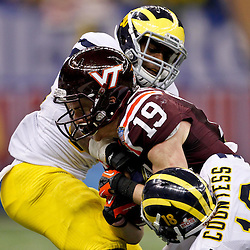 January 3, 2012; New Orleans, LA, USA; Michigan Wolverines safety Thomas Gordon (30) and defensive back Blake Countess (18) tackle Virginia Tech Hokies wide receiver Danny Coale (19) during the fourth quarter of the Sugar Bowl at the Mercedes-Benz Superdome. Michigan defeated Virginia 23-20 in overtime. Mandatory Credit: Derick E. Hingle-US PRESSWIRE