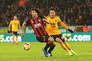 Nathan Ake (5) of AFC Bournemouth and Wolverhampton Wanderers forward Helder Costa (10) during the Premier League match between Wolverhampton Wanderers and Bournemouth at Molineux, Wolverhampton, England on 15 December 2018.