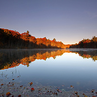 Scenic fall foliage photography images of a stunningly beautiful Rhode Island pond surrounded by autumn peak colors are available as museum quality photography prints, canvas prints, acrylic prints or metal prints. Prints may be framed and matted to the individual liking and decorating needs at<br /> <br /> http://juergen-roth.pixels.com<br /> <br /> This nature photography image captures glorious New England colors during Rhode Island peak fall foliage season. The pond was beautifully painted in warm hues at sunrise providing outstanding color contrast and a perfect water reflection. This nature photography picture is sharp and displays the beautiful colors of autumn in all tones.<br /> <br /> Good light and happy photo making!<br /> Juergen <br /> <br /> Fine Art Prints: http://juergen-roth.pixels.com <br /> Image Licensing: http://www.RothGalleries.com <br /> www.facebook.com/naturefineart <br /> @NatureFineArt