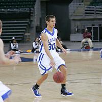 Forward Luke Schroepher  brings the ball up court