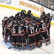 Members of the Northeastern Huskeis huddle during The Beanpot Championship Game at TD Garden on February 10, 2014 in Boston, Massachusetts. (Photo by Elan Kawesch)
