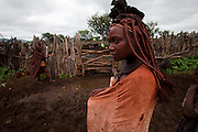 Viahondjera Musutua, a Himba woman who lives in the small village of Ondjete in northwestern Namibia, stands next to a corral where she and other Himba women milk cows every morning. (Viahondjera Musutua is featured in the book What I Eat: Around the World in 80 Diets.) MODEL RELEASED.