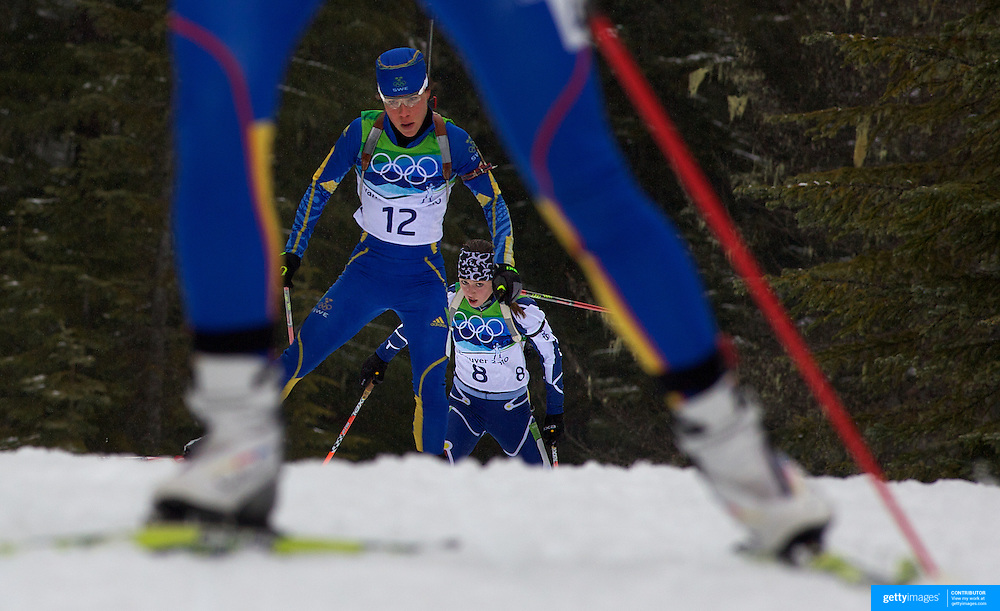 Winter Olympics, Vancouver, 2010.Eva Tofalvi, Roumania (27), Sofia Domeij, Sweden (12) and Tanja Karisik, Bosnia and Herzegovinia (8) in action during the Women's 7.5 KM Sprint Biathlon at The Whistler Olympic Park, Whistler, during the Vancouver  Winter Olympics. 13th February 2010. Photo Tim Clayton
