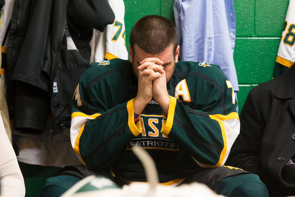 George Mason forward, Justin Satkowski, prays in the locker room before playing host to Liberty University at Prince William Ice Rink in Woodbridge, VA on January 24, 2014.