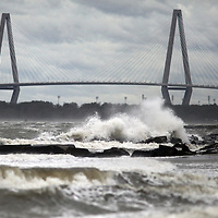 Waves crash near Sullivan's Island in front of the Ravenel Bridge on Saturday as Hurricane Matthew moved away. (ANDREW KNAPP/STAFF)
