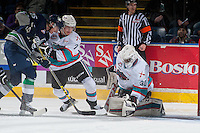 KELOWNA, CANADA - FEBRUARY 8: Andreas Schumacher #15 of Seattle Thunderbirds is checked by Lucas Johansen #7 in front of Michael Herringer #30 of Kelowna Rockets  on February 8, 2016 at Prospera Place in Kelowna, British Columbia, Canada.  (Photo by Marissa Baecker/Shoot the Breeze)  *** Local Caption *** Andreas Schumacher; Lucas Johansen; Michael Herringer;