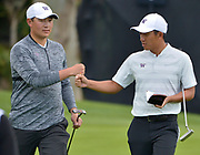 (l-r) Carl Yuan gets a fist bump from C.T. Pan after Yuan made birdie on the first hole. Yuan plays for the University of Washington. College players were paired with tour pros during the Collegiate Showcase during the Genesis Open at Riviera Country Club. The low scoring college player will get an exemption to play in the tournament that begins on Thursday. Los Angeles, CA 1/025/2018 (Photo by John McCoy)