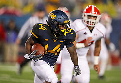 Sep 8, 2018; Morgantown, WV, USA; West Virginia Mountaineers running back Tevin Bush (14) runs the ball during the third quarter against the Youngstown State Penguins at Mountaineer Field at Milan Puskar Stadium. Mandatory Credit: Ben Queen-USA TODAY Sports