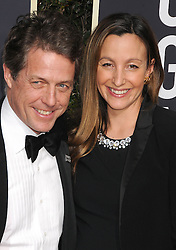 Hugh Grant and Anna Eberstein at the 75th Annual Golden Globe Awards, held at the Beverly Hilton Hotel in Beverly Hills
