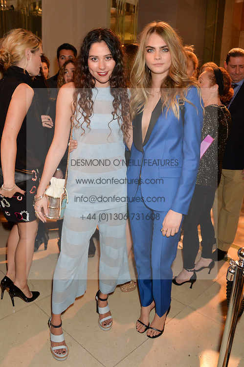 Left to right, ELIZA DOOLITTLE and CARA DELEVINGNE at a Dinner to celebrate the launch of the Mulberry Cara Delevingne Collection held at Claridge's, Brook Street, London on 16th February 2014.