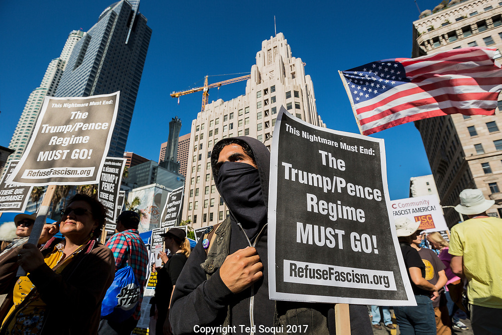 Pro-Trump supporter hold a counter rally and march through downtown Los Angeles on the open year anniversary off Trump's election win. About 70 pro-trump demonstrators marched through the Skid Row area taunting locals and waiving American flags.