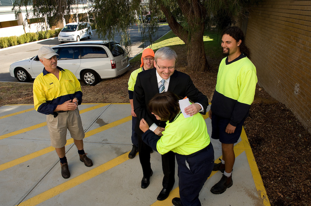 Prime Minister Kevin Rudd shares a laugh with workers as he arrives to host a jobs forum at the City of Cockburn Administration Centre in Spearwood, Western Australia