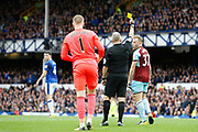 Referee Jon Moss shows Burnley midfielder Scott Arfield (37) the yellow card for simulation during the Premier League match between Everton and Burnley at Goodison Park, Liverpool, England on 1 October 2017. Photo by Craig Galloway.